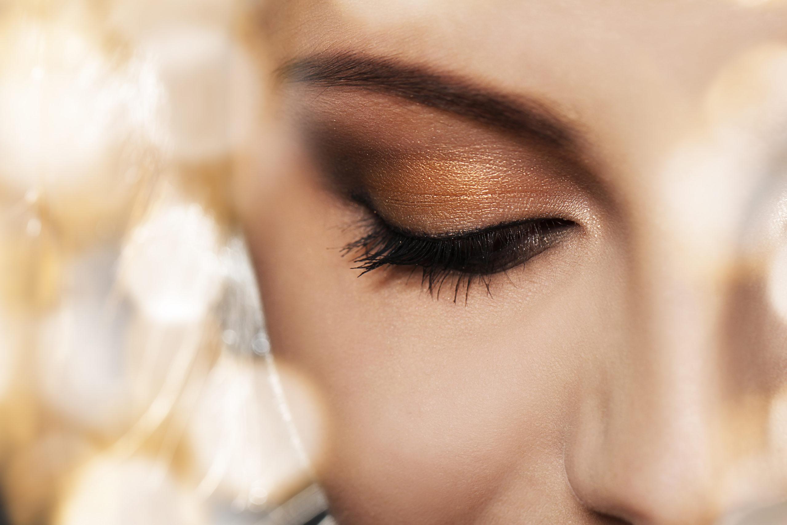 Close up of woman face with eye makeup